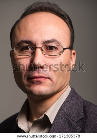 businessman in a suit and glasses looking at the camera, close up, age thirty-five, thirty-seven years