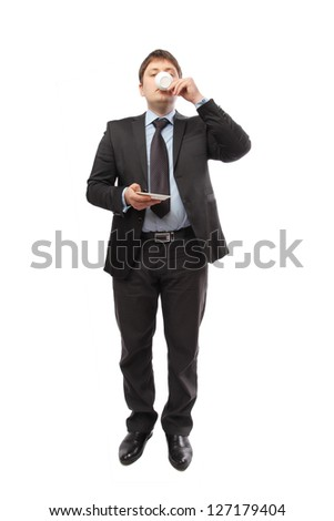 Businessman in a suit drinking coffee at work