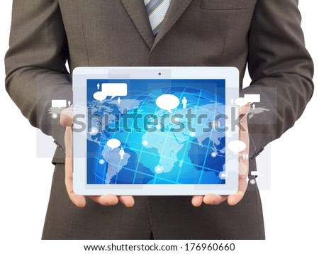 Businessman in a suit holding a tablet computer. The screen tablet - contacts and world map