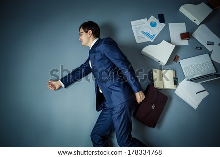 Businessman in a suit in studio - stock photo