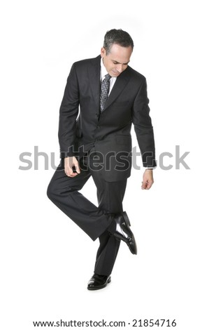 Businessman in a suit looking at his shoe isolated on white background