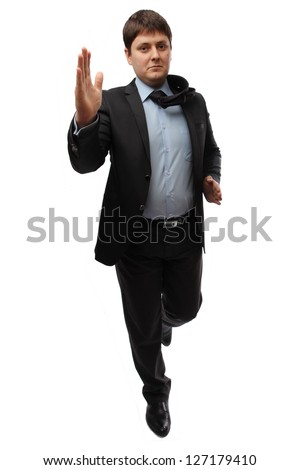 Businessman in a suit running a business meeting
