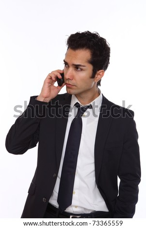 Businessman in a suit talking on his wireless phone