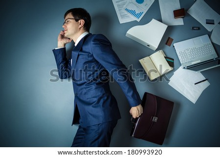 Businessman in a suit talking on the phone - stock photo