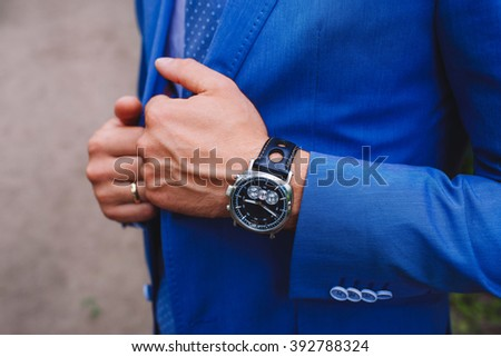Businessman in a suit. Watch on his arm