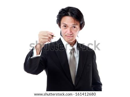 Businessman in a suit with a gold tie color holding a pen and writing something, isolated on white background - stock photo