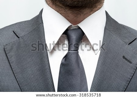 businessman in a suit with a tie and white shirt with close - stock photo