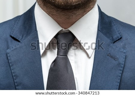 businessman in a suit with a tie and white shirt with close