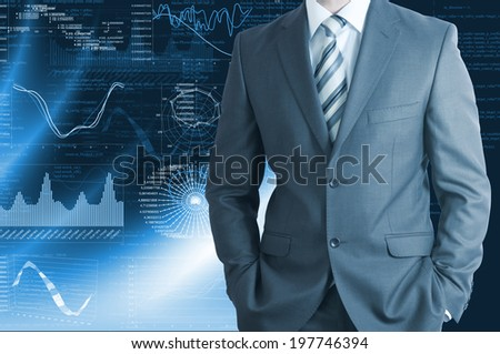 Businessman in a suit with background of graphics. Business concept - stock photo