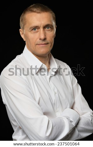 Businessman in a white shirt on a black background - stock photo