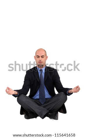 Businessman in a yoga position - stock photo