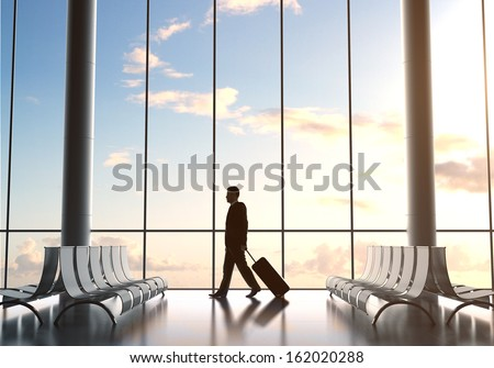 businessman in airport and airplane in sky - stock photo