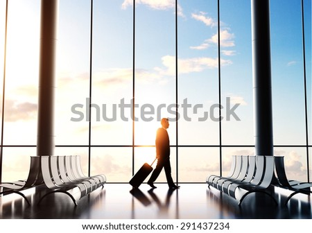 businessman in airport with luggage - stock photo