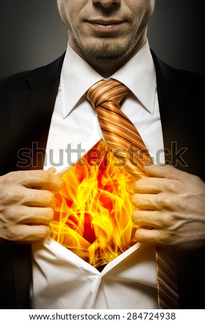 businessman  in black costume throw open one's shirt, blaze in soul - stock photo