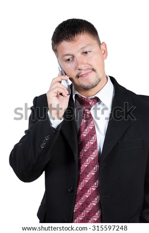 Businessman in black suit and tie holding your smartphone near your ear isolated on a white background - stock photo