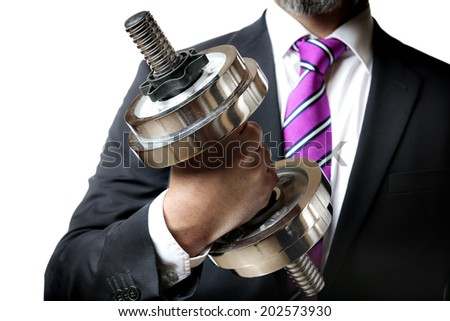 Businessman in black suit holding a silver dumbbell in the right hand - stock photo