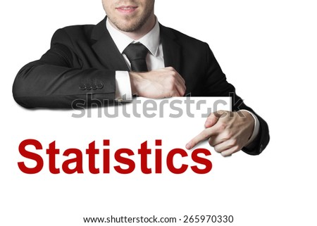 businessman in black suit pointing on sign statistics - stock photo
