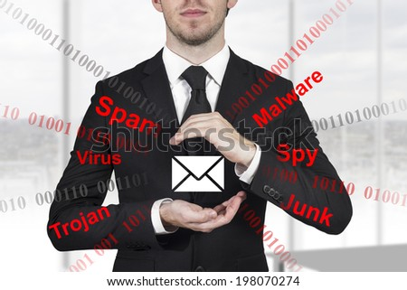 businessman in black suit protecting mail from spam attack malware with hands - stock photo