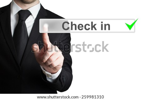 businessman in black suit pushing button check in isolated - stock photo