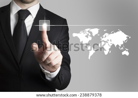 businessman in black suit pushing button worldmap global communication - stock photo