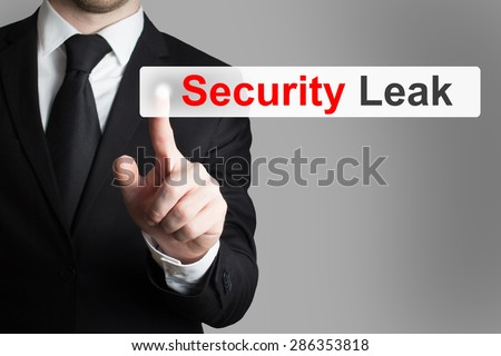businessman in black suit pushing touchscreen security leak - stock photo