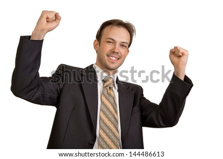 Businessman in black suit rejoices in victory