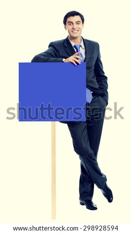 businessman in blue tie, showing blank signboard with blank copyspace area for text or slogan - stock photo