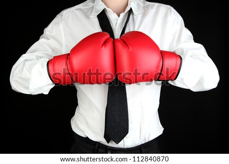 businessman in boxing gloves isolated on black - stock photo