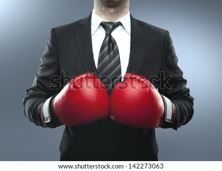businessman in boxing gloves isolated on blue