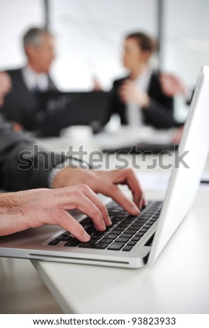 Businessman in business ambiance working on laptop