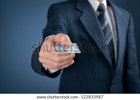 Businessman in business suit pay by credit card.
