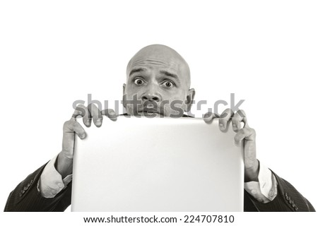 businessman in crisis and stress at computer laptop holding monitor looking guilty after doing something wrong as internet gambling isolated on white background - stock photo