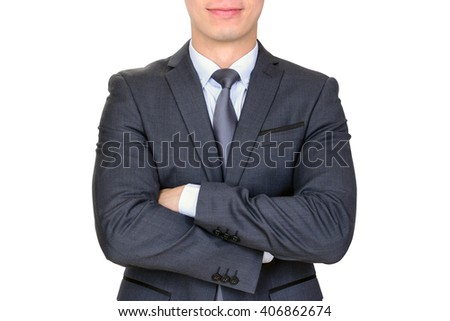 Businessman in dark gray suit folding his arms - isolated on white background