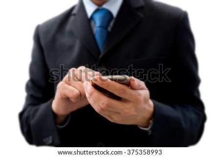 Businessman in dark gray suit using smartphone for business