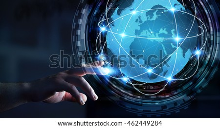Businessman in dark office using digital tactile world interface with his finger
