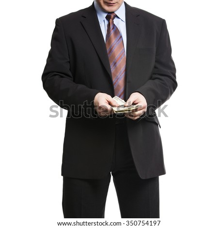 Businessman in dark suit counts a bunch of American Dollars. Isolated on white background.