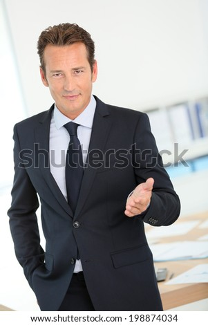 Businessman in dark suit making business presentation - stock photo