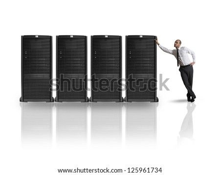 Businessman in datacenter server room - stock photo