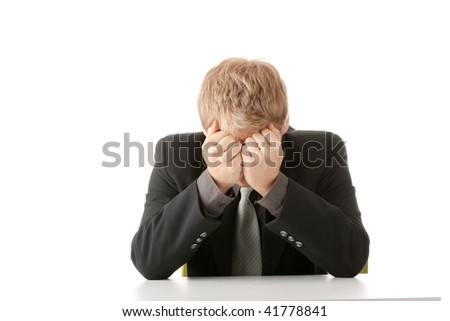 Businessman in depression with hand on forehead, isolated over white - stock photo