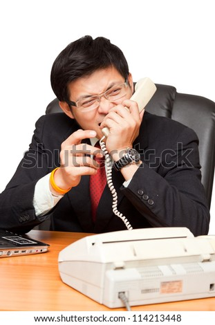 Businessman in distress on a white background, with clipping path.