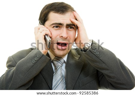 Businessman in distress speaks by phone on a white background - stock photo