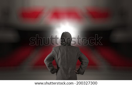 businessman in front of a podium and an audience as concept - stock photo