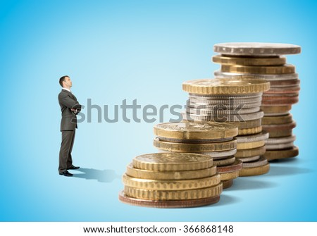 Businessman in front of coins