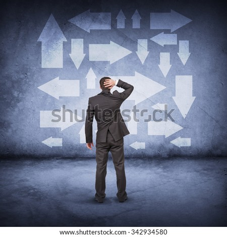 Businessman in front of different ways, rear view - stock photo