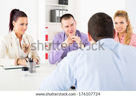 Businessman in front of the commission having a job interview. - stock photo