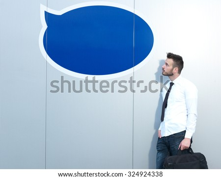 Businessman in front of thought bubble, creative background, bubble  for your text
