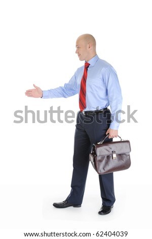 Businessman in full-length stretches out his hand for a handshake. Isolated on white background - stock photo