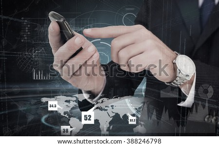 Businessman in glasses using his tablet pc against black and grey interface
