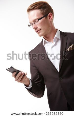 businessman in glasses with a telephone