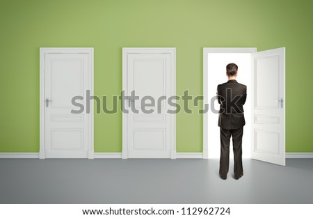 businessman in green room with three door - stock photo